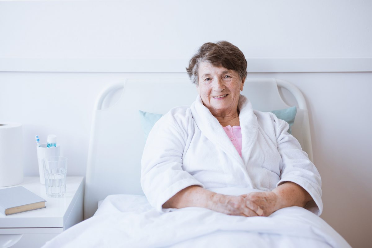 Lady-in-hospital-bed-1200x801.jpg